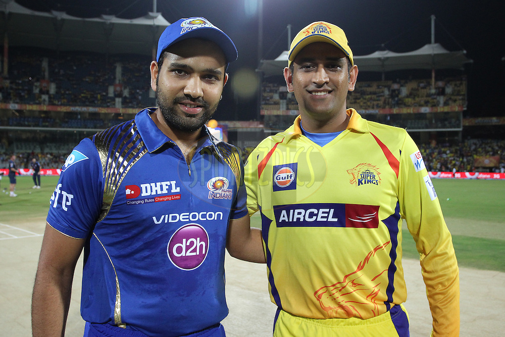 Mumbai Indians captain Rohit Sharma and Chennai Super Kings Captain MS Dhoni during match 43 of the Pepsi IPL 2015 (Indian Premier League) between The Chennai Super Kings and The Mumbai Indians held at the M. A. Chidambaram Stadium, Chennai Stadium in Chennai, India on the 8th May April 2015.<br /> <br /> Photo by:  Shaun Roy / SPORTZPICS / IPL
