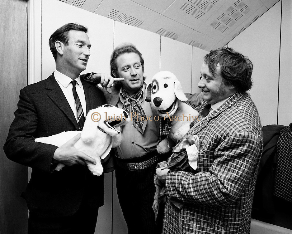 "The launch of 'Judge' a new Cork made soft toy, modelled on the famous dog from RTE's popular children's programme 'Wanderly Wagon'. Picture shows 'Judge' admiring his likeness. he is accompanied by (l-r), Gerard Colley, Managing Director, Orla Agencies LTD; Bill Golding, who played 'Rory' on the series and Eugene Lambert, who played O'Brien"" as well as being the puppeteer who designed the original dog. 'Judge' also featured in TV road safety advertisements.  <br />