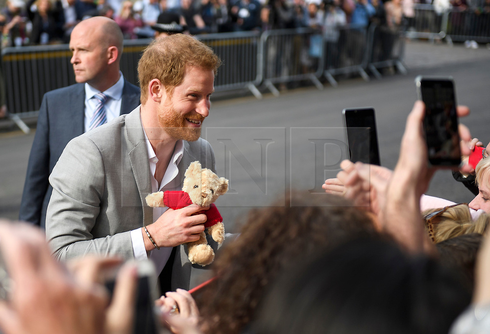 © Licensed to London News Pictures. 18/05/2018. London, UK. PRINCE HARRY holds a teddy bear toy given to him while on a walkabout outside Windsor Castle on the eve of the wedding of Prince Harry to Meghan Markle.. Prince Harry and Meghan Markle are to be married tomorrow (Saturday) at St George's Chapel in Windsor. Photo credit: Ben Cawthra/LNP