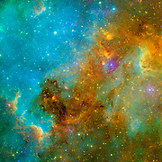 This new view of the North America nebula combines both visible and infrared light observations, taken by the Digitized Sky Survey and NASA's Spitzer Space Telescope, respectively, into a single vivid picture.