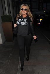 Lauren Goodger arriving at the Mayfair Hotel wearing a T-shirt with the words 'Call My Agent', black leather bikers jacket, skinny jeans and Christian Louboutin shoes. London, UK. 12/03/2014<br />
