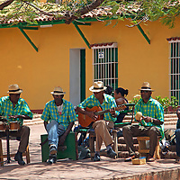 Central America, Cuba, Trinidad. Cuban musicians on the streets of Trinidad.