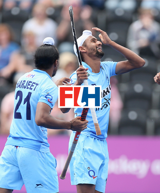 LONDON, ENGLAND - JUNE 24:Mandeep Singh of India celebrates scoring their teams sixth goal with teammate Harjeet Singh during the 5th-8th place match between Pakistan and India on day eight of the Hero Hockey World League Semi-Final at Lee Valley Hockey and Tennis Centre on June 24, 2017 in London, England. (Photo by Alex Morton/Getty Images)