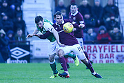 16 Connor Randall and 16 Lewis Stevenson clash during the William Hill Scottish Cup 4th round match between Heart of Midlothian and Hibernian at Tynecastle Stadium, Gorgie, Scotland on 21 January 2018. Photo by Kevin Murray.