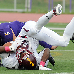 Bloomsburg's Ryan Dickerson (7) is taken down by West Chester's Matt Colyar (5), after Dickerson caught a pass. TK4