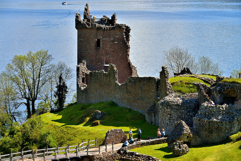 Grant Tower at Urquhart Castle at Loch Ness in Scottish Highlands, Scotland <br /> The centerpiece of the Urquhart Castle is the Grant Tower. This five-level, 40 foot stone keep was named after John Grant.  In 1509, James IV of Scotland gave Grant a lifetime lease on the property in return for repairing and maintaining it. The ruins are a major tourist attraction.  After  crossing over the bridge, you can walk around the 14th century walls enclosing the Nether Bailey (courtyard), climb the tower and explore the foundations of its past buildings and rooms.