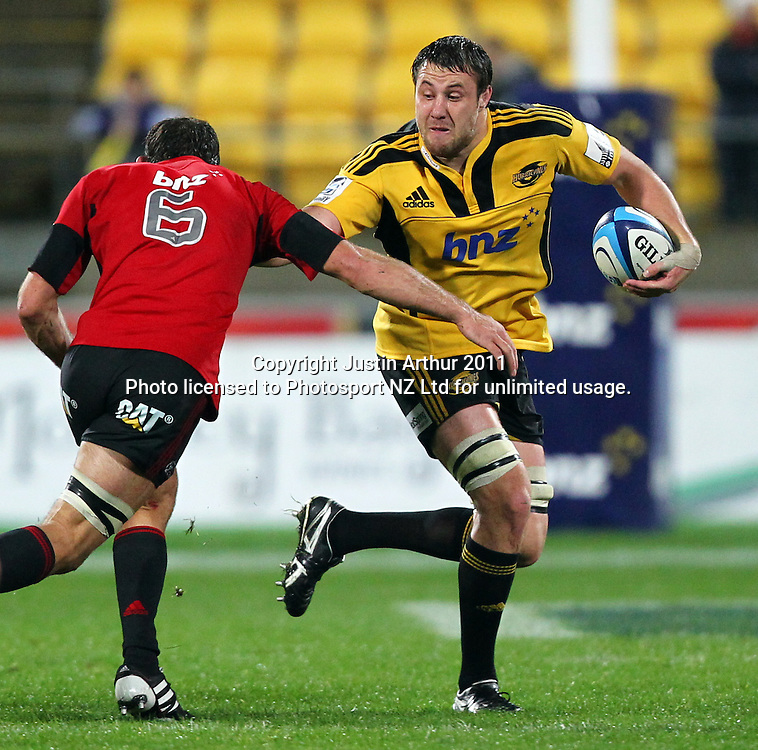Hurricanes Jeremy Thrush fends off George Whitelock .Super15 rugby union match - Crusaders v Hurricanes at Westpac Stadium, Wellington, New Zealand on Saturday, 18 June 2011. Photo: Justin Arthur / photosport.co.nz