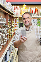Mature salesperson reading instructions in hardware store