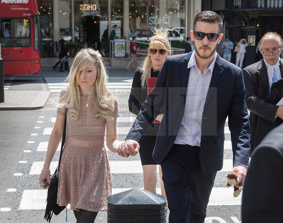 © Licensed to London News Pictures. 25/05/2017. London, UK.  CONNIE YATES AND CHRIS GARD arrive at The Royal Courts of Justice in London where an appeal court is expected to rule on whether doctors can withdraw life-support treatment for their son, Charlie, who suffers from a rare genetic condition.   Doctors at Great Ormond Street Hospital in London say eight-month-old Charlie should be left to die in dignity, but his parents have raised over £1 million for specialist treatment in America. Photo credit: Peter Macdiarmid/LNP