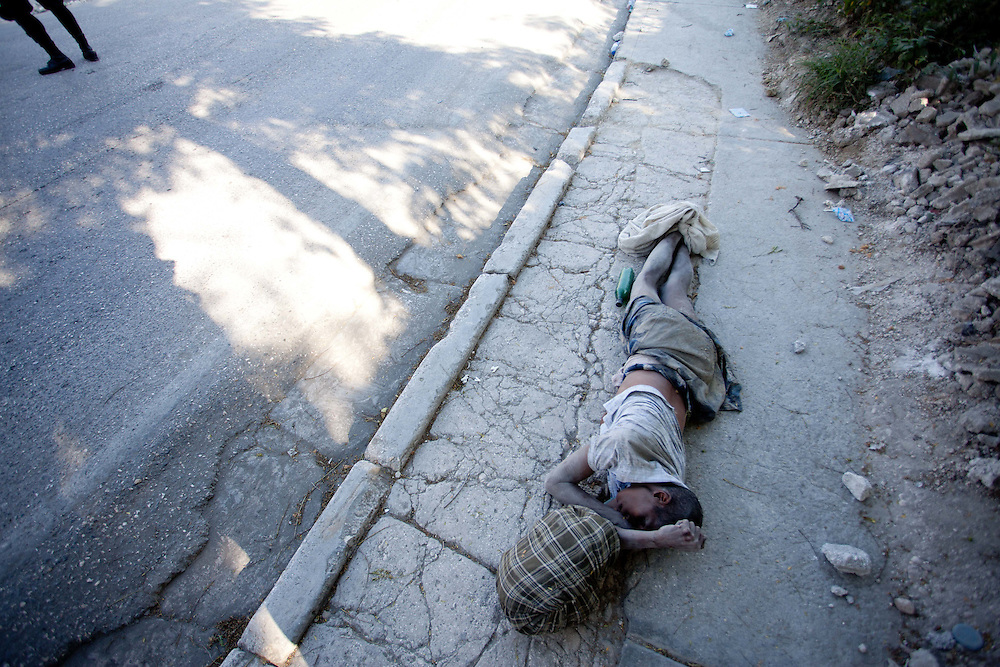 A woman beleived to have died from cholera lies on the sidewalk for two days before being picked up by workers hired by the department of health to pick up dead cholera victims.