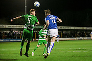 Mark Gray (North Ferriby United) and Ritchie Sutton (Tranmere Rovers) jump for the ball during a Tranmere Rovers attack during the Vanarama National League match between North Ferriby United and Tranmere Rovers at Eon Visual Media Stadium, North Ferriby, United Kingdom on 21 March 2017. Photo by Mark P Doherty.