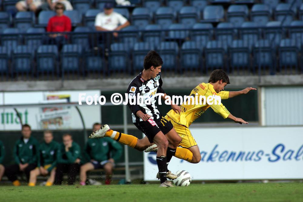 21.08.2005, Veritas Stadion, Turku, Finland..Veikkausliiga 2005 / Finnish League 2005.TPS Turku v IFK Mariehamn.Jarno Auremaa (TPS) kaataa IFK:n Andr? Hansellin..©Juha Tamminen.....ARK:k