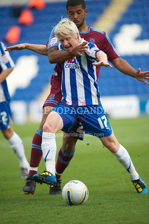 COLCHESTER, ENGLAND - Saturday, September 25, 2010: Tranmere Rovers' Joss Labadie puts his hands all over Colchester United's David Perkins during the League One match at the Colchester Community Stadium. (Photo by Gareth Davies/Propaganda)