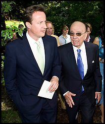 File Picture of Prime Minister David Cameron pictured talking to News Corp Chairman Rupert Murdoch at the wedding of Rebecca Wade to Charlie Brooks in June 2009. Photo By Julian Andrews/i-Images..25/04/12. Pics © Copyright Julian Andrews 2012...NOTE TO DESK...PERMISSION TO USE MUST BE OBTAINED BEFORE EVERY USE OF THIS PICTURE...PICTURE HAS A MANDATORY CREDIT  AND A MINIMAL REPRODUCTION FEE OF £200 IN PRINT AND £75 ONLINE...PICTURE MUST NOT BE ARCHIVED OR USED WITHOUT PRIOR PERMISSION...