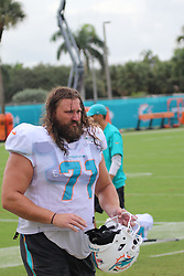 FILE PHOTOS: The Miami Dolphins have lost starting left guard Josh Sitton for the season due to a torn rotator cuff, a league source said Friday. Also a huge NFL record comes to an end for John Denney who held the longest consecutive record Denney snapped for punts and field goals in his 209th consecutive Dolphins game, a team record for longevity and the longest streak among active NFL players. It's also a lesson in talent, perseverance, endurance, attention to detail and luck. The Miami Dolphins also suffered a tremendous blow with a season ending injury to guard Josh Sitton is a four-time Pro Bowler who had signed a 2-year, $18 million deal with the club this offseason.As the Dolphins transformed their roster before this season, they had looked to add players who were tough, scrappy, committed and had experienced winning. Before the season, quarterback Ryan Tannehill said he felt more comfortable behind this year's offensive line than any he had before. Tannehill had been virtually untouched throughout the preseason and was sacked only once in the opener, by an unblocked player.The Dolphins will replace Sitton in the starting lineup with Ted Larsen, who took almost all the practice work at left guard throughout training camp on days Sitton was held out to rest. Larsen will start on Sunday against the New York Jets. Sitton, 32, previously had issues with his right shoulder. A source said this injury was on the opposite side.This is a serious blow to the Dolphins. Sitton not only was perhaps the Dolphins best run-blocker but had taken on something of a mentor role with left tackle Laremy Tunsil. The Miami Dolphins also added long snapper Lucas Gravelle to their practice squad on Tuesday, a move that could help the team brace for the possibility of a lingering shoulder injury longtime long snapper John Denney has. Denney has appeared in an NFL-record 209 consecutive games since signing with the Dolphins as a rookie in 2005 (by far a team record and an NFL record