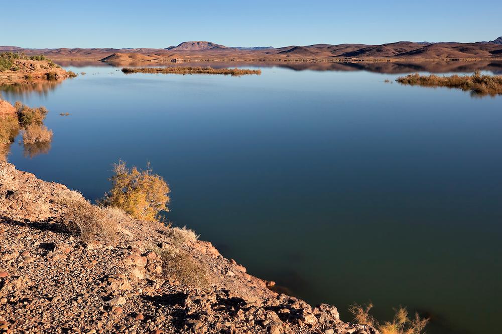 El-Mansour Eddabbi dam with mountains, Ouarzazate, Morocco.