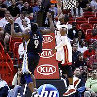 12 March 2011: Miami Heat shooting guard Dwyane Wade (3) blocks Memphis Grizzlies shooting guard Tony Allen (9) during the Miami Heat 118-85 victory over the Memphis Grizzlies at the AmericanAirlines Arena, Miami, Florida, USA.