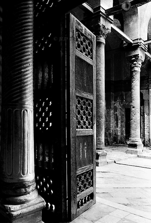 Mosque, tomb, and madrasa of Qala'un, Cairo, built 1283-85. Interior, mashrabeyya doors, opening toward the columned courtyard.  An atmosphere of peace and calm pervades the space.