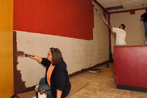 (from left) Becky Stapleton of Tipp City, Marty Wunderink of Vandalia and Jody Willoughby of Tipp City help the Ginghamsburg Church create a new church on East Main Street in Trotwood, Saturday, February 4, 2012.  The church church will share space with the YMCA, in partnership with the YWCA Neighborhood Development Association.