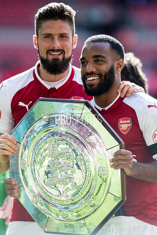 Arsenal forward Olivier Giroud (12), Arsenal forward Lacazette (9) celebrate win during the FA Community Shield match between Arsenal and Chelsea at Wembley Stadium, London, England on 6 August 2017. Photo by Sebastian Frej.