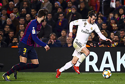 February 6, 2019 - Barcelona, Spain - FC Barcelona's defender Gerard Pique   (L) and GARETH BALE  during semifinal of spanish King Cup frist leg match between FC Barcelona and Real Madrid at  Nou Camp Stadium on February  6, 2019. (Credit Image: © Jose Miguel Fernandez/NurPhoto via ZUMA Press)