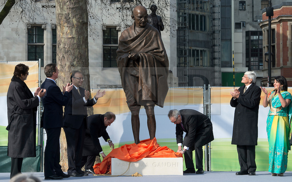 © Licensed to London News Pictures. 14/03/2015. <br /> LONDON, UK. British Prime Minister, David Cameron unveils a 9ft-high bronze statue of civil rights leader, Mahatma Gandhi in Parliament Square, central London today. Photo credit: Hannah McKay/LNP