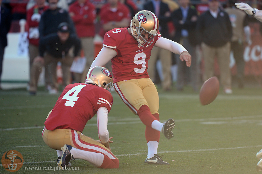 December 1, 2013; San Francisco, CA, USA; San Francisco 49ers kicker Phil Dawson (9) kicks a field goal out of the hold by punter Andy Lee (4) against the St. Louis Rams during the third quarter at Candlestick Park. The 49ers defeated the Rams 23-13.
