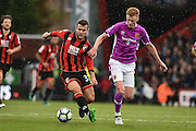 AFC Bournemouth Midfielder, Jack Wilshere (32) ands Hull City Midfielder, Sam Clucas (11) during the Premier League match between Bournemouth and Hull City at the Vitality Stadium, Bournemouth, England on 15 October 2016. Photo by Adam Rivers.