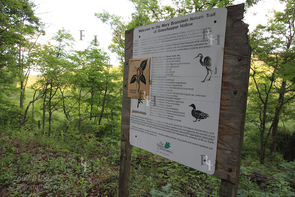 Informational sign describes fauna and flora at Grasshopper Hollow, the largest, most significant fen complex in unglaciated North America; Reynolds, Missouri.