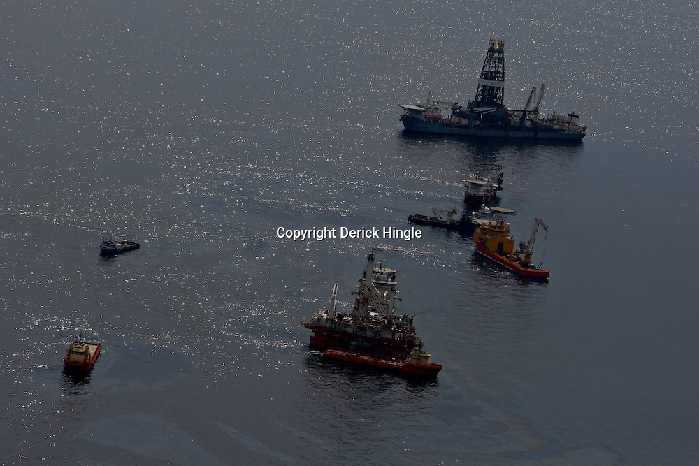 Oil is seen on the surface of the water around support vessels, at the site of the Deepwater Horizon oil spill in the Gulf of Mexico near the coast of Louisiana, U.S., on Wednesday, June 2, 2010. BP Plc has given up trying to plug its leaking well in the Gulf of Mexico any sooner than August, laying out a series of steps to pipe the oil to the surface and ship it ashore for refining, said Thad Allen, the U.S. government's national commander for the incident. Photographer: Derick E. Hingle