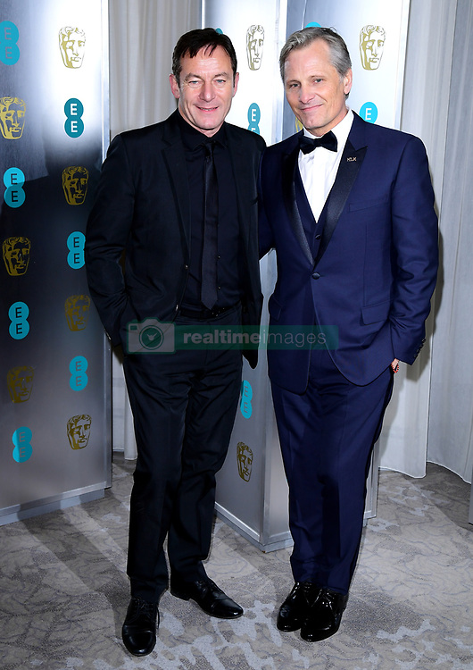 Jason Isaacs and Viggo Mortensen (right) attending the after party for the 72nd British Academy Film Awards at the Grosvenor House Hotel in central London.