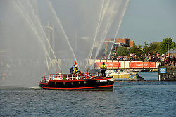 © Licensed to London News Pictures. 31/05/2012. Bristol, UK.  File picture of The Pyronaut fireboat at the Olympic torch celebrations in Bristol harbour on 22 May 2012.  The Pyronaut has been taken out of the water at Bristol marina to go to London to take part in the regatta on the Thames as part of the Queen's Diamond Jubilee celebrations.  Photo credit : Simon Chapman/LNP