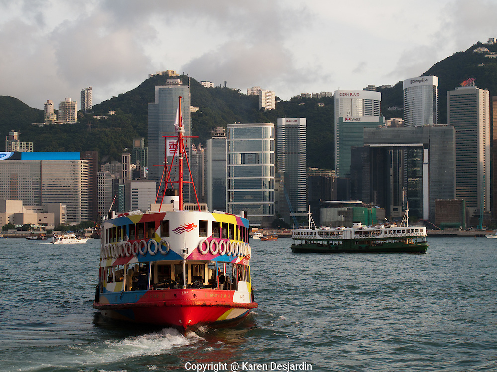 Ferries cross Victoria Harbour on their way toward Central district, Hong Kong.