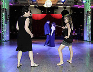 Lydia Brazie, 12, from Vandalia (right) strikes a pose while mother Karen looks on and Julio and Tina Gonzalez, from Miamisburg dance at the 21st birthday party of the Human Race Theatre Company in Sinclair's Ponitz Center, Saturday night, April 28th.