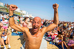 © Licensed to London News Pictures. 06/07/2016. Brighton, UK. Supporters watch the England Vs Sweden World Cup 2018 match on the big screen on the Beach in Brighton and Hove.  Photo credit: Hugo Michiels/LNP