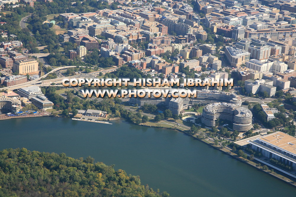 Aerial View of Washington DC featuring Georgetown Harbor, Georgetown Residential District, The John F. Kennedy Center for the Performing Arts, Watergate Complex, The Downtown District, Roosevelt Island and The Potomac River.