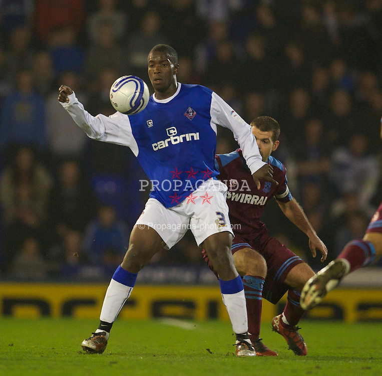 OLDHAM, ENGLAND - Monday, March 28, 2011: Oldham Athletic's Oumare Tounkara in action against Tranmere Rovers during the Football League One match at Boundary Park. (Photo by David Rawcliffe/Propaganda)