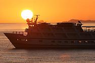 Sun rises over Lindblad's Sea Lion cruise ship at Isla San Esteban in Sea of Cortez, Baja, Mexico.