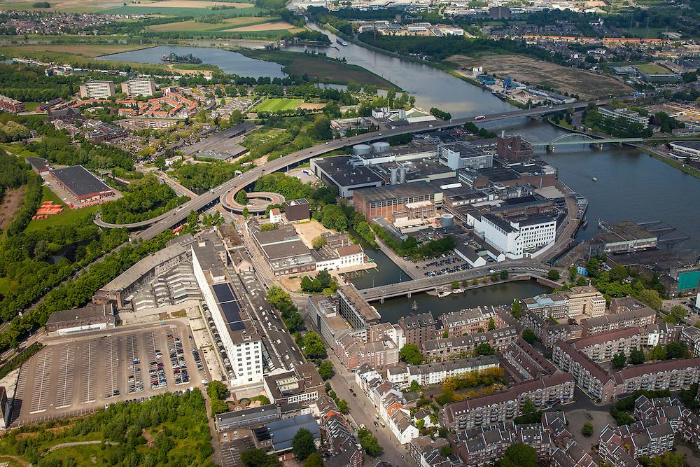Nederland, Limburg, Gemeente Maastricht, 27-05-2013; De Maas met de Noorderbrug  en spoorbrug, gezien in Noordelijke richting. <br /> Fabrieksterrein van de voormalige Koninklijke Sphinx met het Eiffelgebouw gebouwd in de jaren 30 in de wijk Belvedere. In oktober 2013 is begonnen met de restauratie van het voormalige fabrieksgebouw aan de Boschstraat. Het gebouw vormt al jaren een landmark voor Maastricht.<br /> North west part of Maastricht, view in Northermn direction. Eiffel Building of the former Royal Sphinx factory (middel bottom) built in the 30s in the Belvedere area of Maastricht. The low-rise building is a well known landmark in Maastricht.<br /> luchtfoto (toeslag op standaardtarieven);<br /> aerial photo (additional fee required);<br /> copyright foto/photo Siebe Swart.