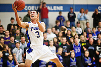 Coeur d'Alene High's Travis Tackett elevates toward the rim after beating the Central Valley High defense down court for the pass during the second half of the Viking's 54-48 win over the Bears.