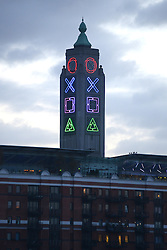 © Licensed to London News Pictures.14/11/2013. London, UK. South Bank's OXO Tower decked out with PlayStation symbols. The traditional OXO symbols on the side of the South Bank tower are being changed to promote the upcoming Playstation 4.Photo credit : Peter Kollanyi/LNP