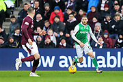 Martin Boyle (#17) of Hibernian looks to take on Aaron Hughes (#5) of Heart of Midlothian during the William Hill Scottish Cup 4th round match between Heart of Midlothian and Hibernian at Tynecastle Stadium, Gorgie, Scotland on 21 January 2018. Photo by Craig Doyle.