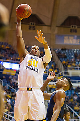 Nov 11, 2016; Morgantown, WV, USA; West Virginia Mountaineers forward Sagaba Konate (50) shoots during the second half against the Mount St. Mary's Mountaineers at WVU Coliseum. Mandatory Credit: Ben Queen-USA TODAY Sports