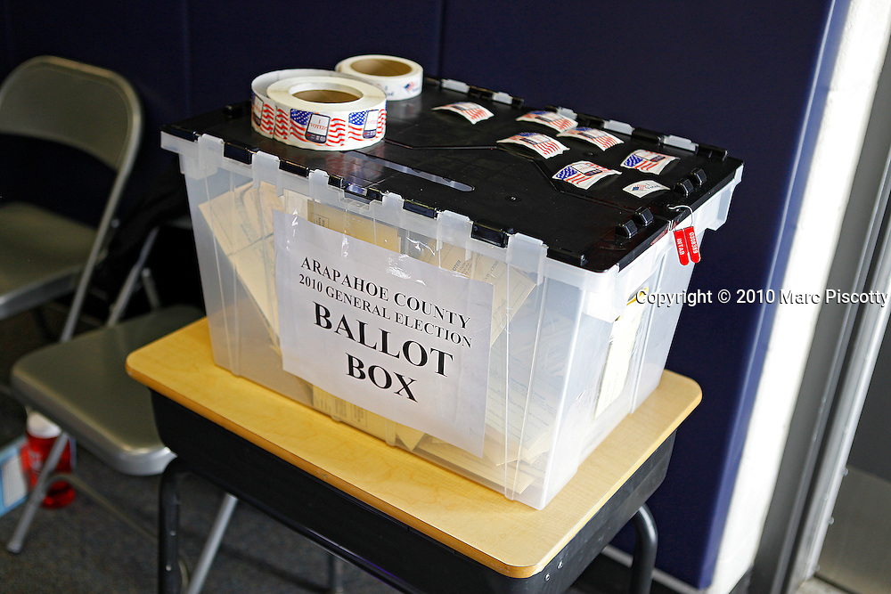 AURORA, CO - NOVEMBER 2: Voters cast their ballots into a ballot box at Red Hawk Elementary School in Aurora, Co. The school is located in Arapahoe County and the county as a whole is traditionally a conservative area although during the last election the county was carried by the Democrats. It is considered a bellweather county by most and will likely end up playing a pivotal role in which direction the state ends up voting. (Photo by Marc Piscotty/ © 2010)
