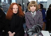 Vogue's Anna Wintour, right, and Grace Coddington pose for a photograph before the Altuzarra Fall 2014 collection is presented during Fashion Week in New York, Saturday, Feb. 8, 2014. (AP Photo/Diane Bondareff)