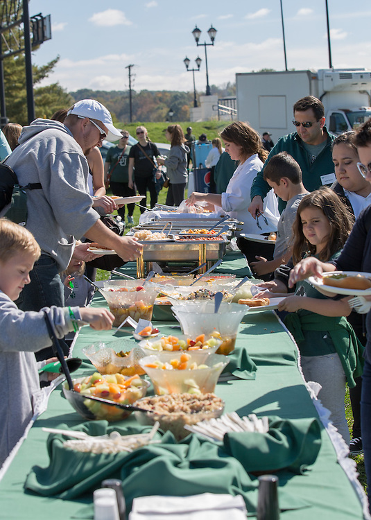 Ohio University College of Business alumni and their families get lunch at the College of Business Tailgating Homecoming event on October 10, 2015 at Ohio University's Tailgreat Park. Photo by Emily Matthews