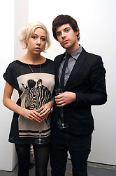 Writer POLLY STENHAM and actor HARRY TREADAWAY at a party to celebrate the publication of Vivienne Westwood's Opus held at The Serpentine Gallery, Kensington Gardens, London W2 on 12th February 2008.<br />