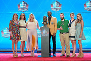Aug 3, 2019; Canton, OH, USA; Champ Bailey (center) poses with bust and the family of the late Pat Bowlen during the Pro Football Hall of Fame Enshrinement at Tom Benson Hall of Fame Stadium. (Robin Alam/Image of Sport)