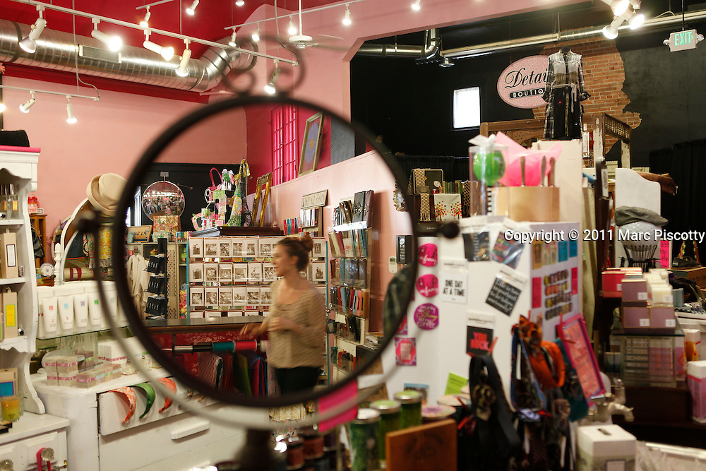 SHOT 9/12/11 3:17:09 PM - Details Boutique on Main Street in Littleton, Co. The store, which has been around for more than 10 years, carries bath & body products, clothing and accessories and is located in a former 1925 silent movie theater in historic Littleton. (Photo by Marc Piscotty /  © 2011)