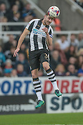 Paul Dummett (Newcastle United) heads the ball during the EFL Cup 4th round match between Newcastle United and Preston North End at St. James's Park, Newcastle, England on 25 October 2016. Photo by Mark P Doherty.